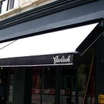 Traditional slide arm awning